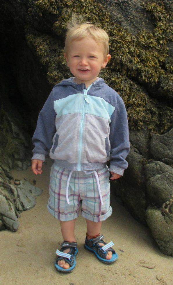 Jake stood on a beach in Cornwall