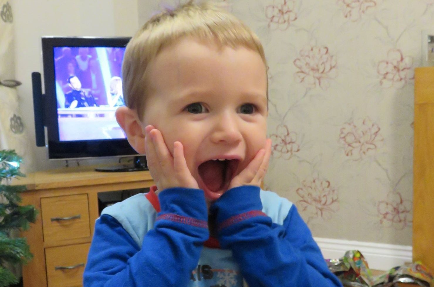 kid with hands on his face. Poem blog