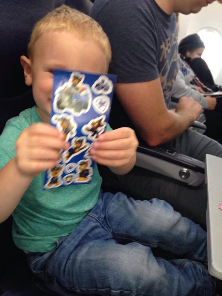 toddler holding up stickers