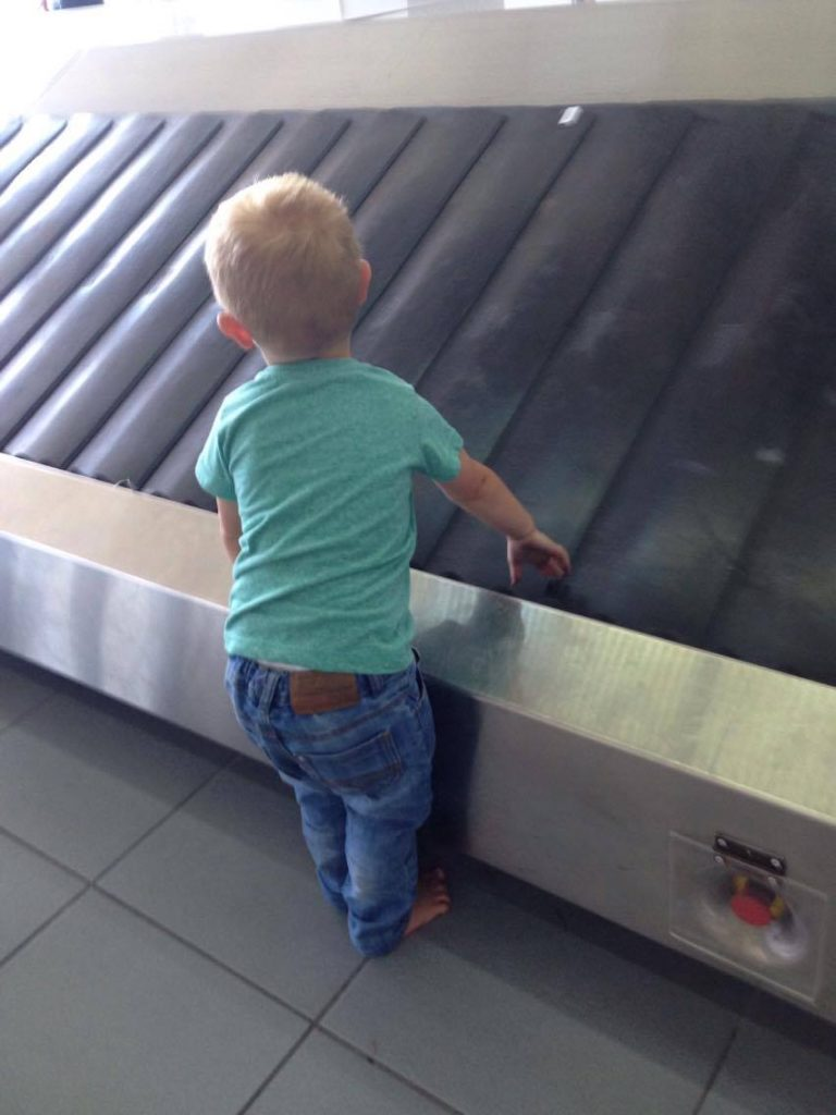 toddler at baggage claim