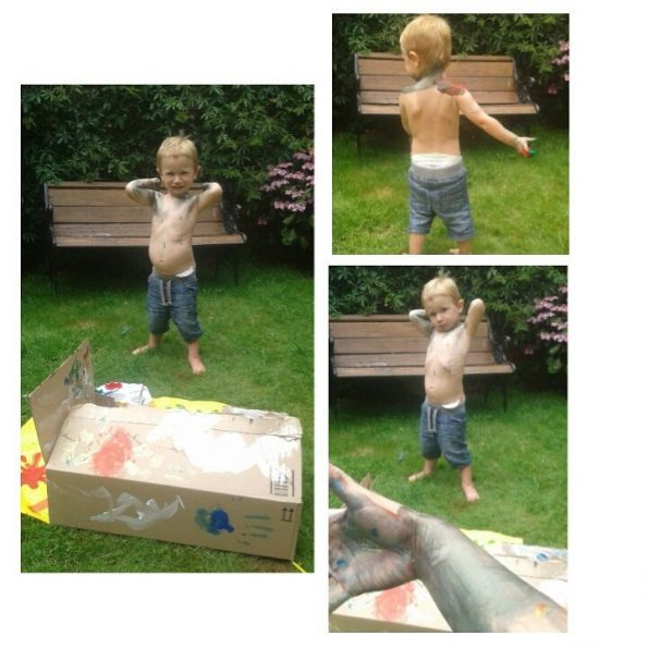 Jake painting himself in the garden