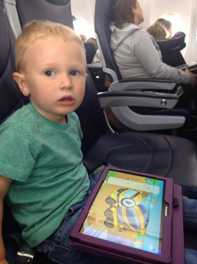 Jake on the plane not looking very happy
