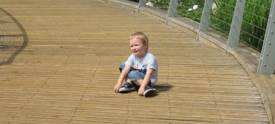 boy sat on ground- toddlerdom