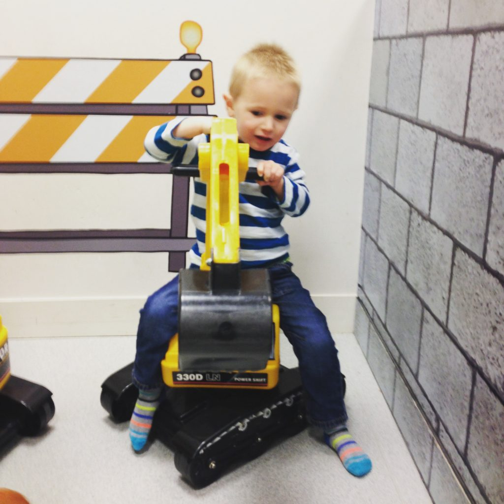 child on toy digger