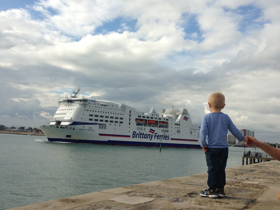 Jake watching a ferry at the sea