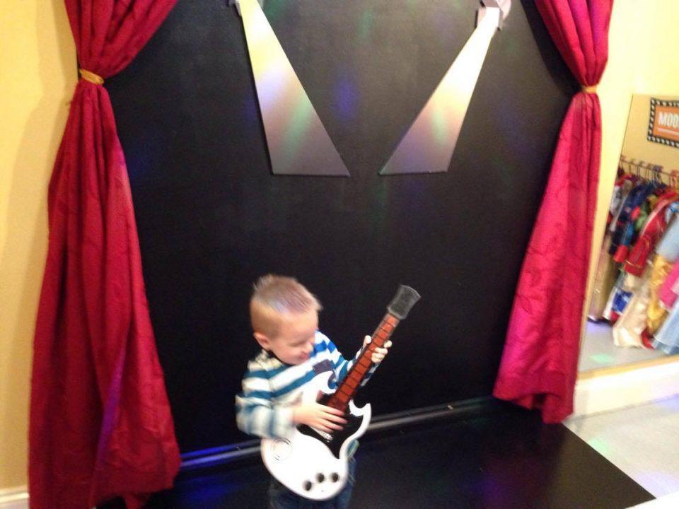 Jake playing a toy guitar