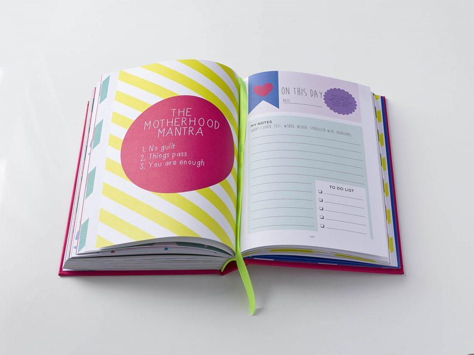 Open book written by surviving Motherhood a great idea for a baby shower gift