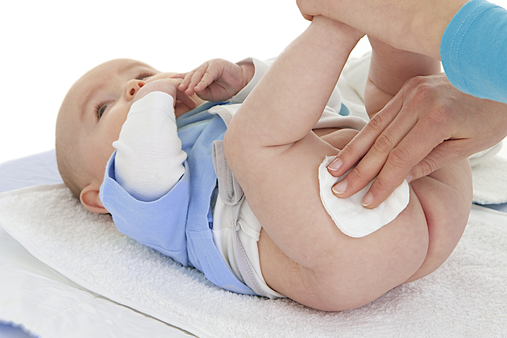 baby having bottom wiped