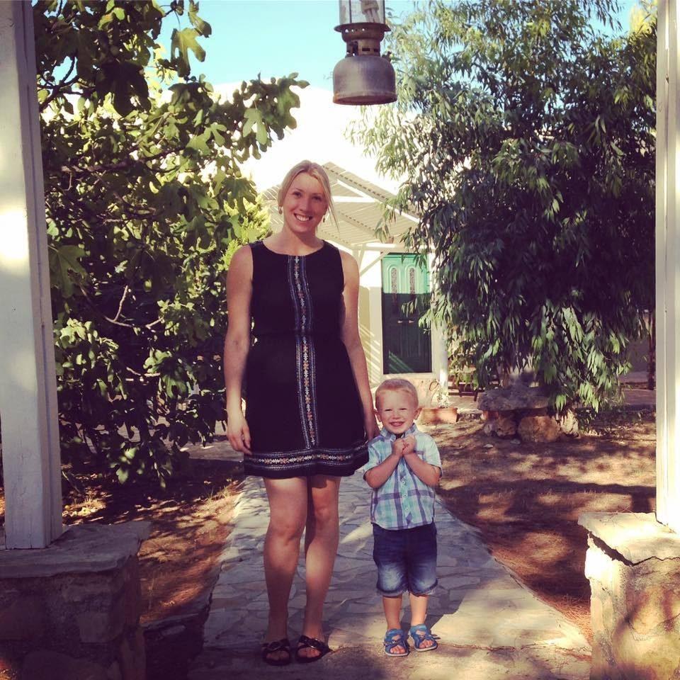Mum and son outside Greek villas