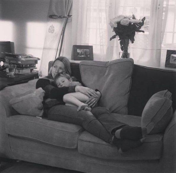 Mummy and child cuddling on the sofa