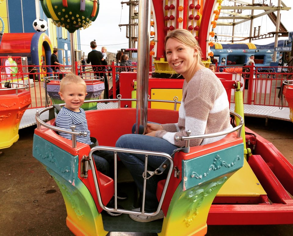 mum and son on a fairground ride