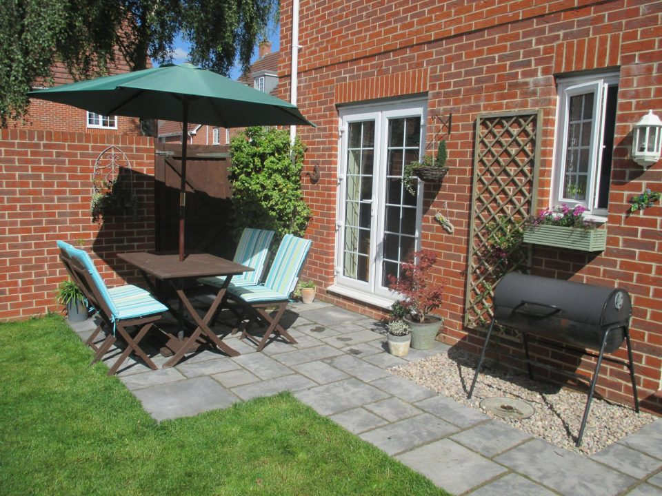 my small garden completed with a gorgeous patio and chairs and table plus plants