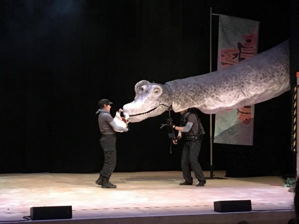 large dino head coming on the stage