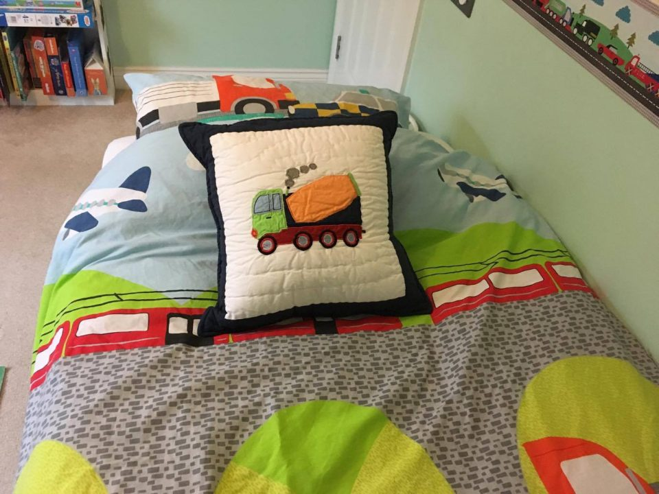 cushion on his bed