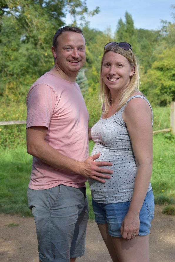 my husband and me with him touching my bump