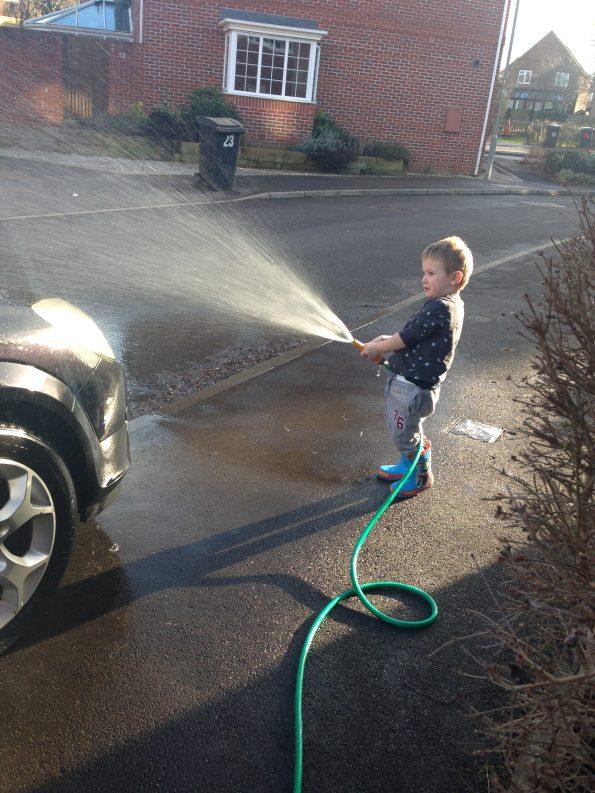 Jake washing my car with a hose