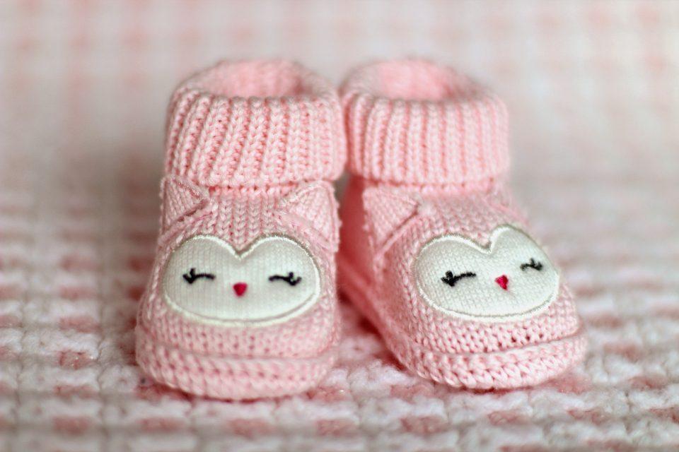2 baby pink booties