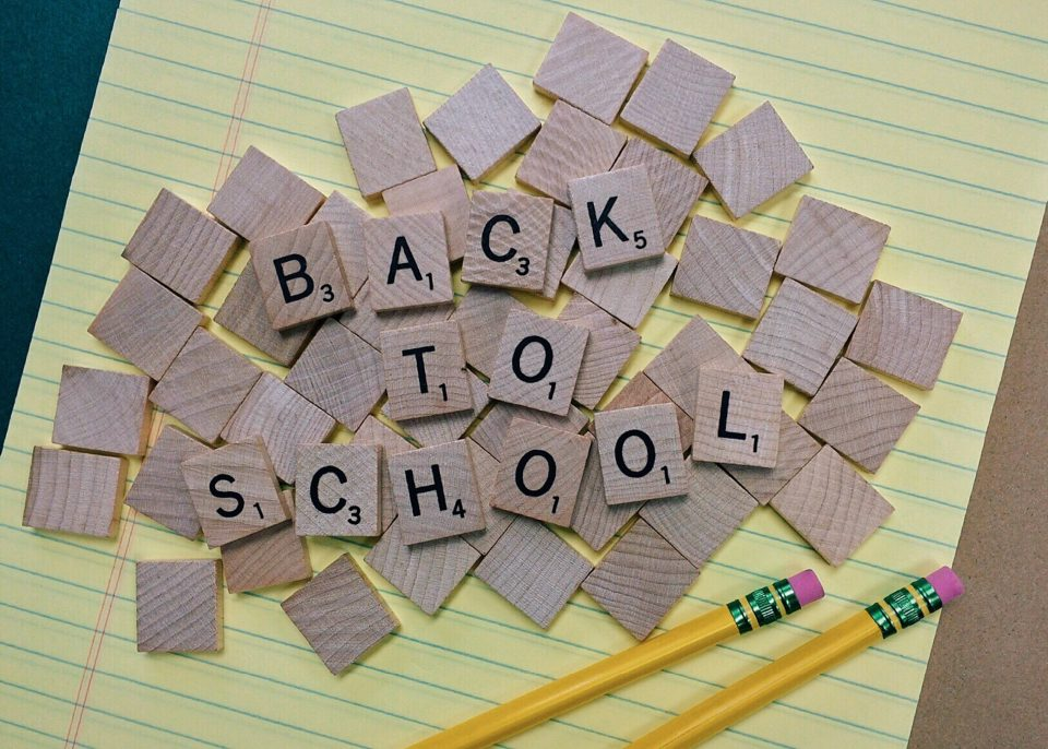 back to school written out on scrabble pieces