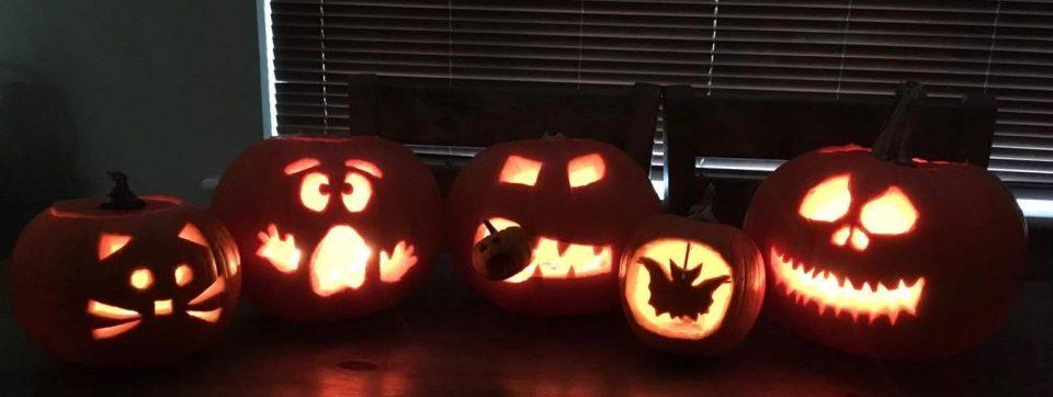 five carved pumpkins