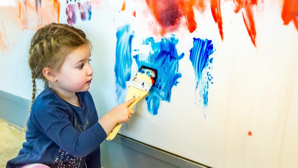 child doing sensory play
