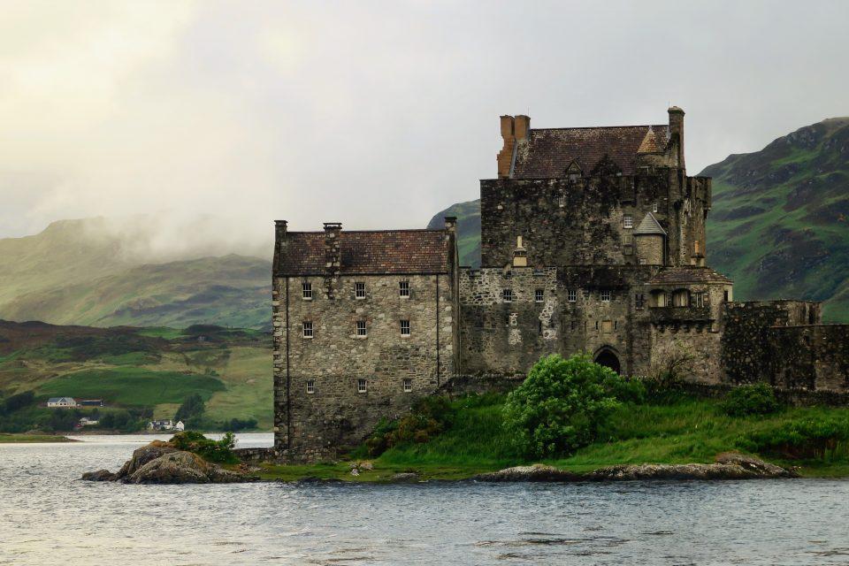 Lake and karge building at John O Groats