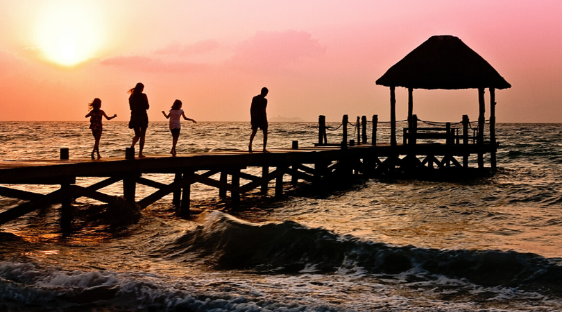 family on holiday at sunset