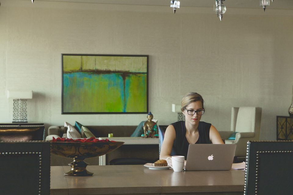 working from home lady at table and laptop