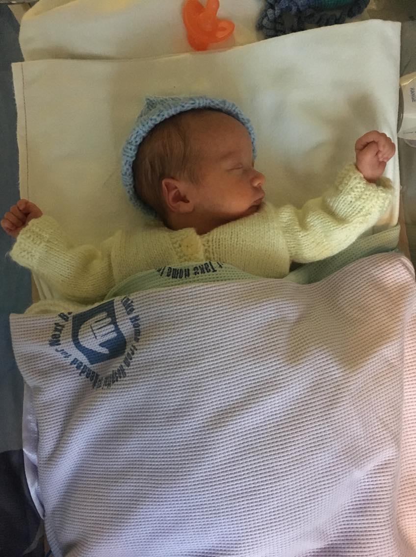 William asleep in his cot in NICU