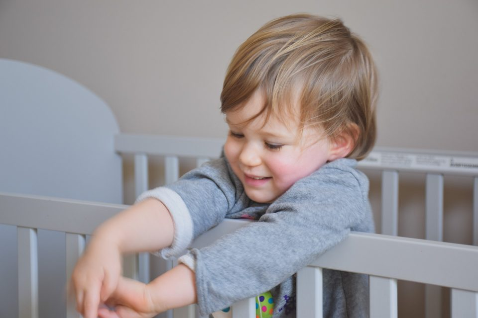 child in a cot