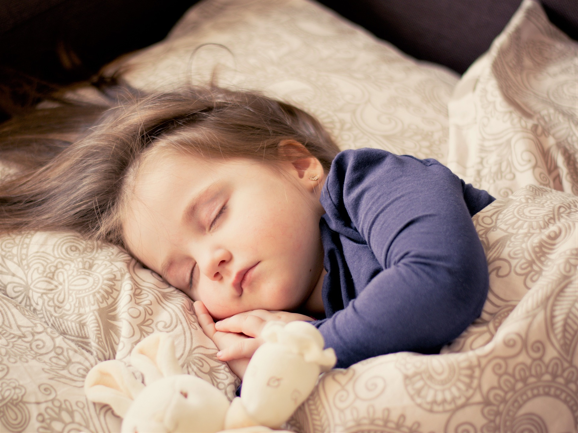 child in bed- childrens health