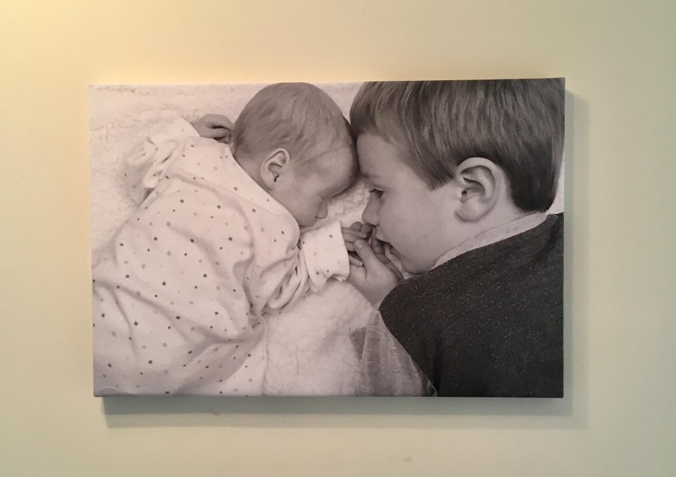 canvas image of baby and boy