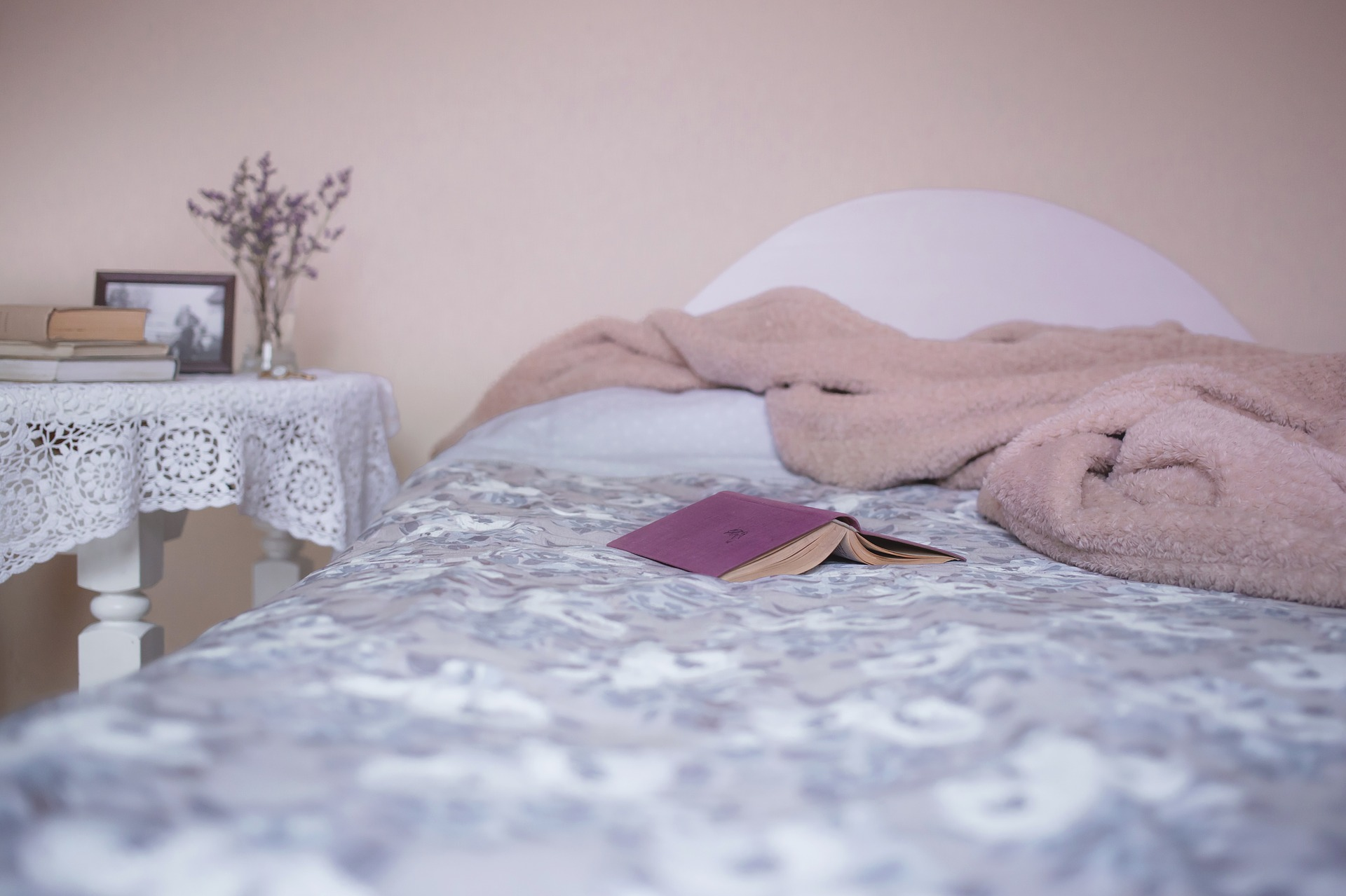 bed with soft furnishings in pink