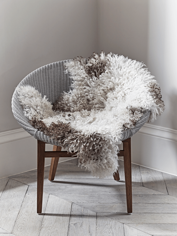chair with a sheepskin rug on it