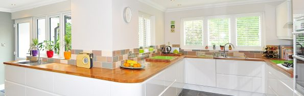 a large spacious kitchen with oak worktops