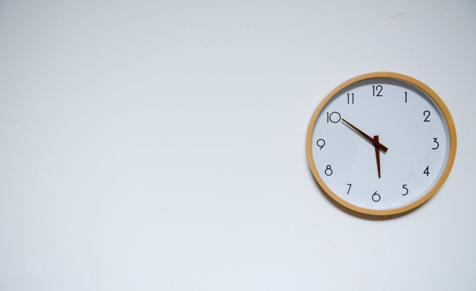 a clock on a white wall