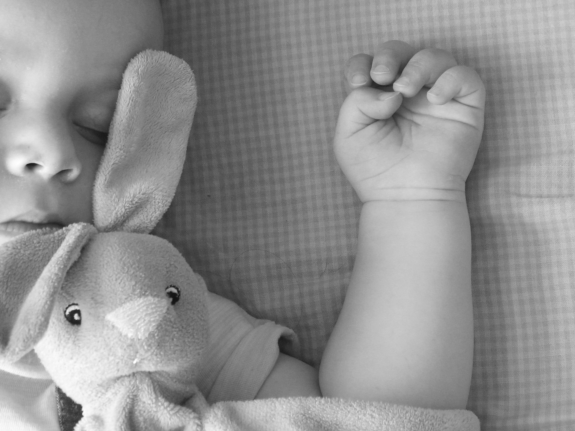 baby asleep in black and white image