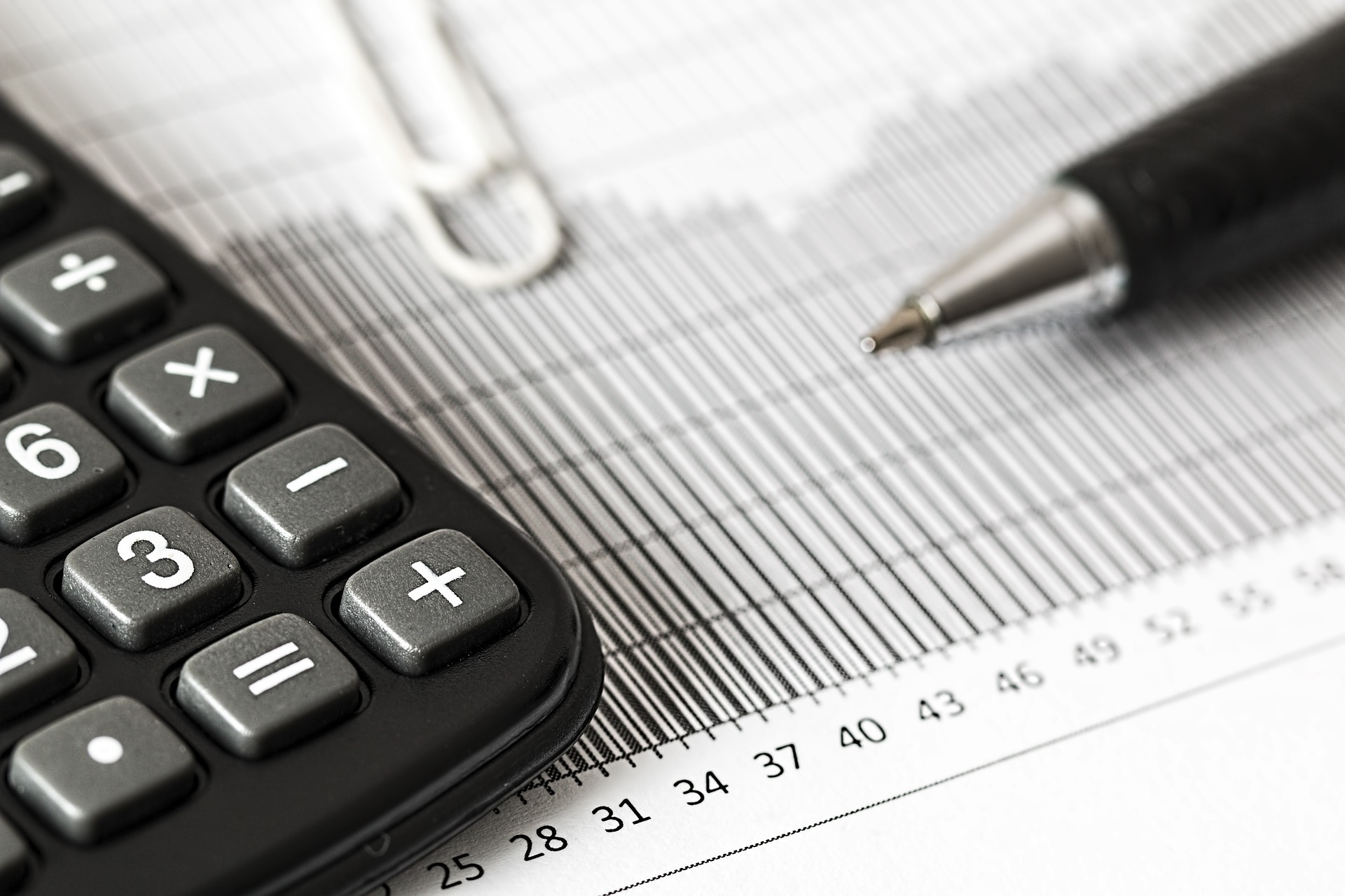 tax return, calculator and pen