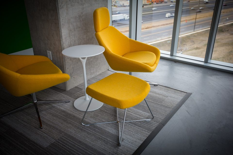 yellow chairs around a white table