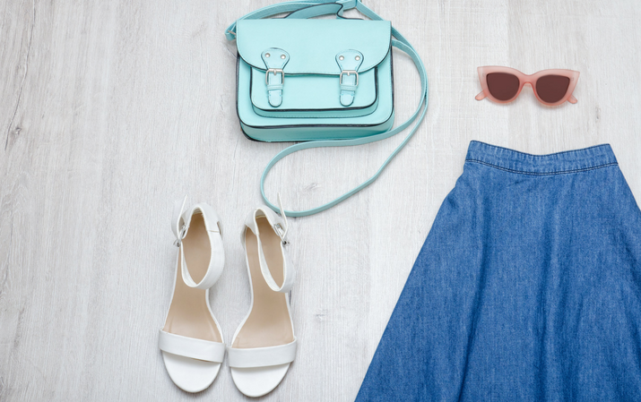 summer look of denim skirt, sandals, bag and sunglasses