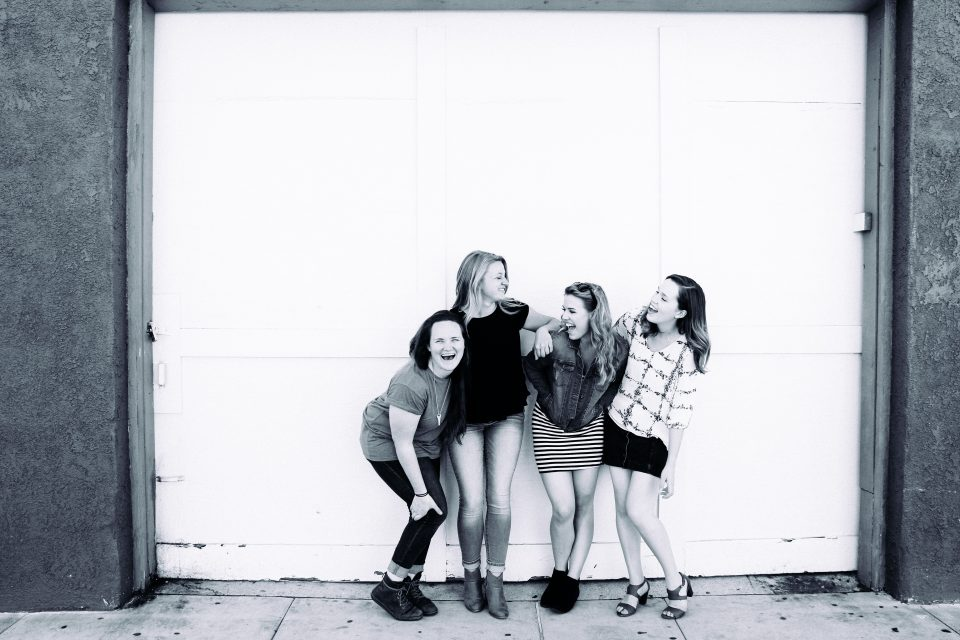 women laughing in black and white photo