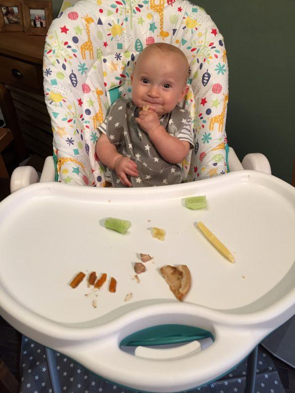baby eating wearing a messy me bib
