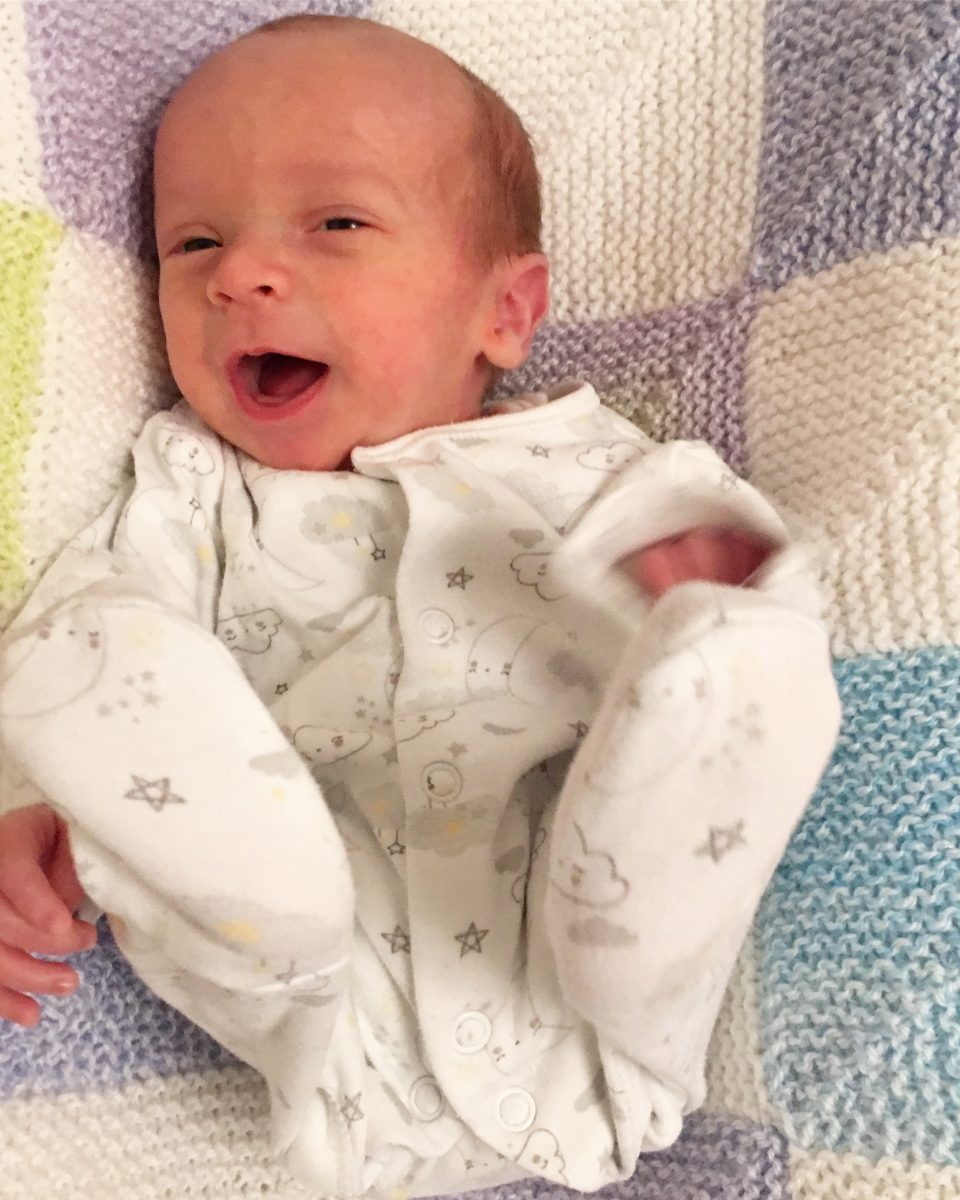 happy premature baby on his due date