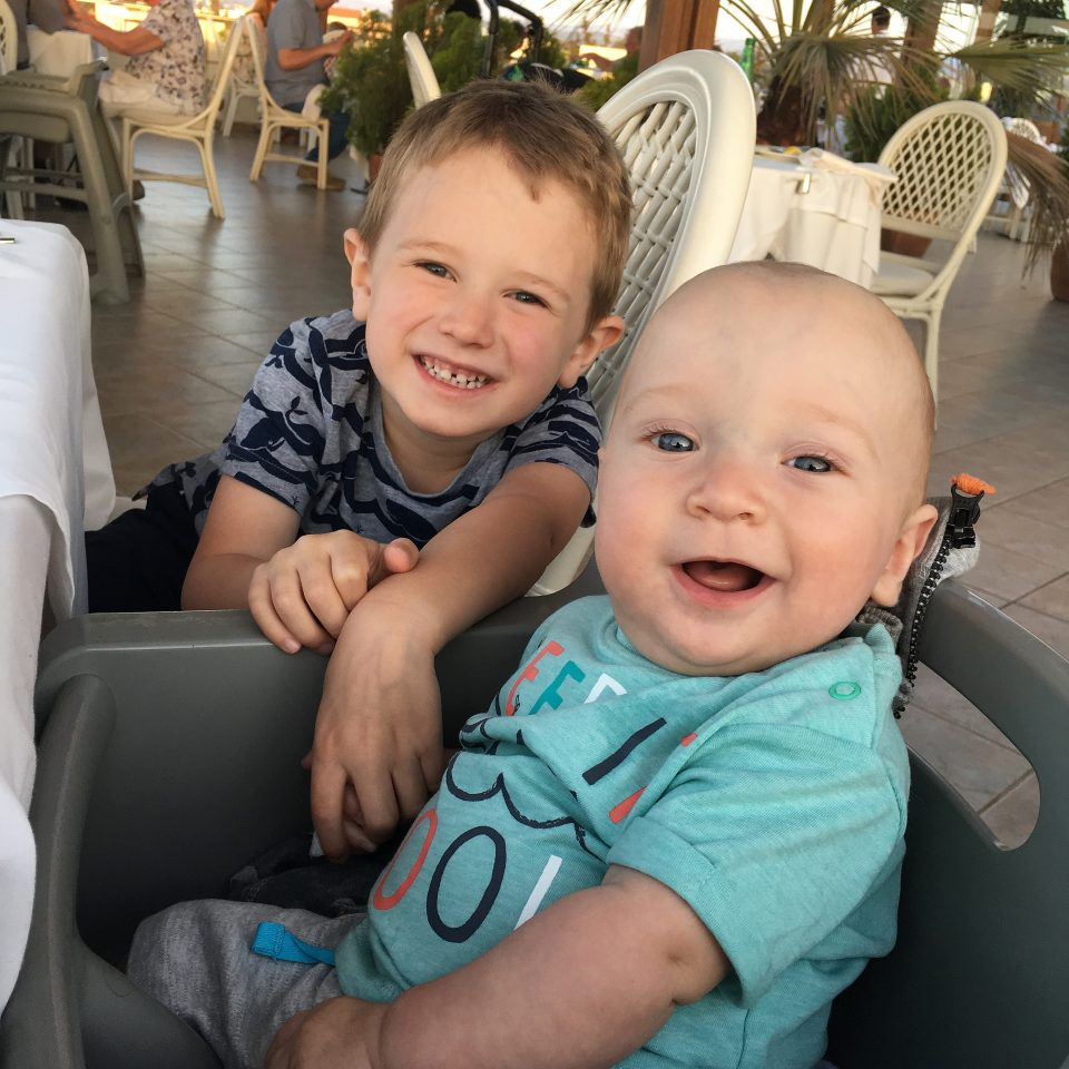 Jake and William in a restaurant on holiday in Crete