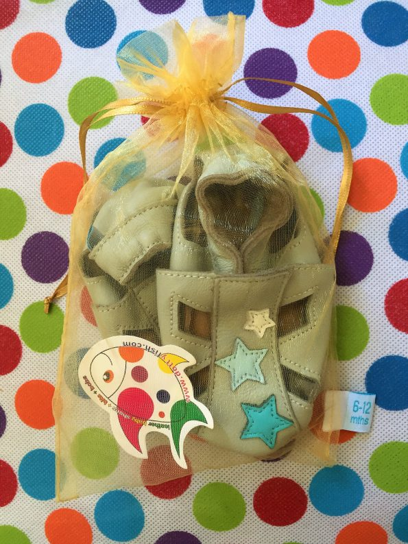 Dotty Fish grey star sandals in their mesh bag