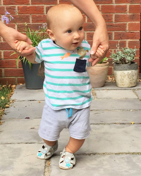baby in his dotty fish sandals