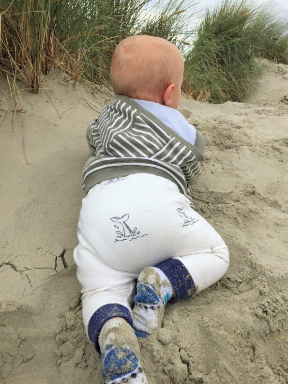 baby in the little drop in the ocean pants a behind shot to show that his reusable nappy fits in there comfortably