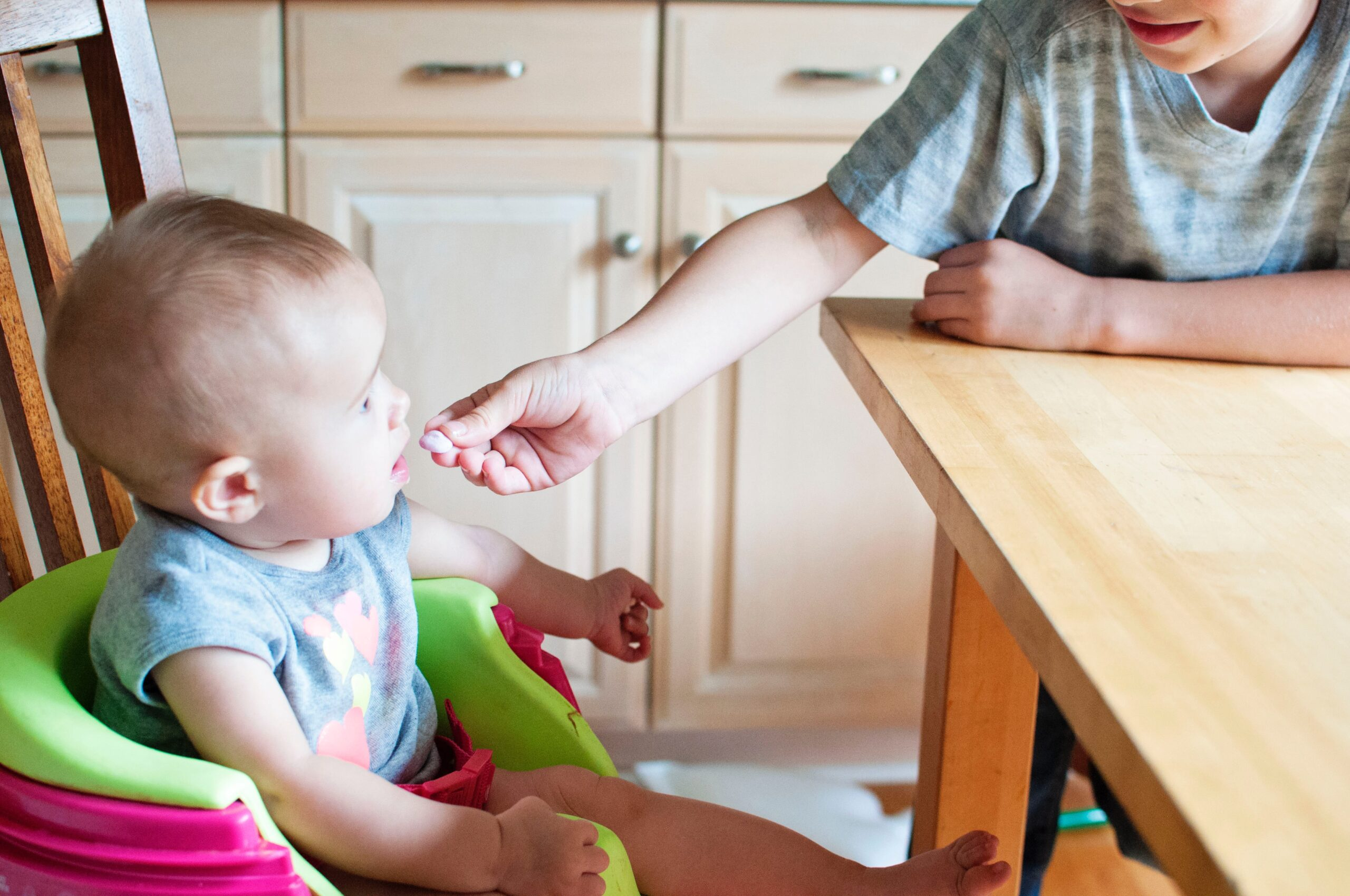 baby eating in a high chair