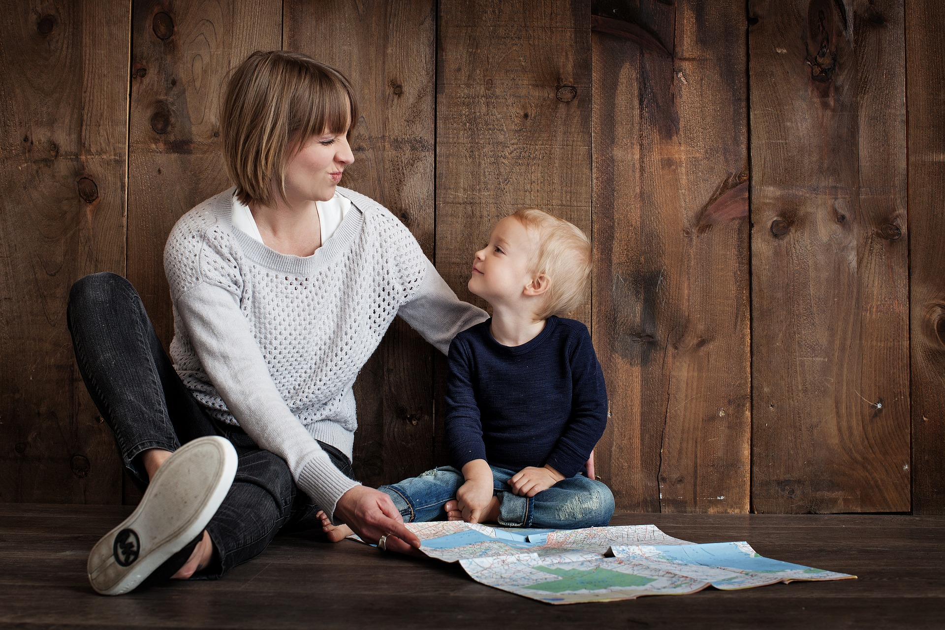 child and mother looking at a map