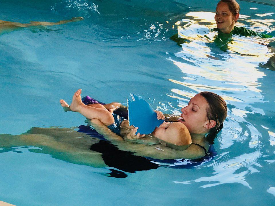 baby swimming with Mummy