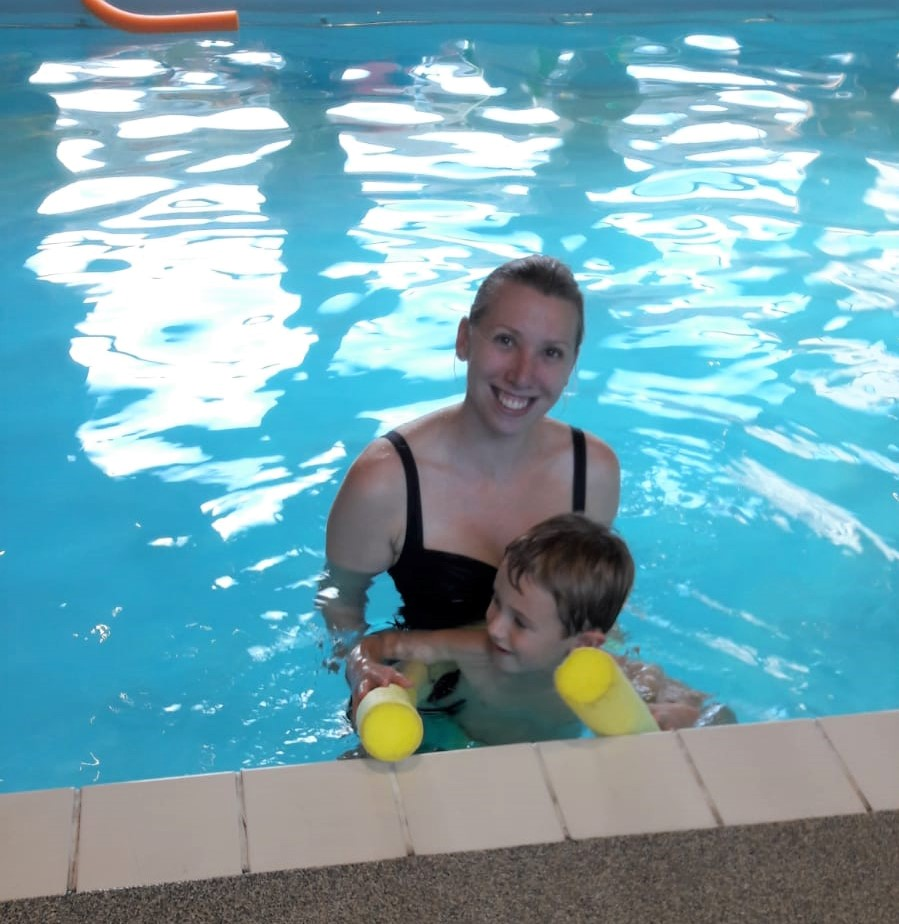 mum and child in a swimming pool